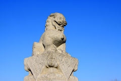Stone lion sculptures in seventeen holes bridge railing Stock Photos