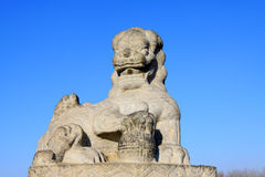 Stone lion sculptures in seventeen holes bridge railing Royalty Free Stock Photos