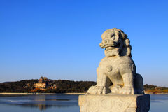 Stone lion sculptures in seventeen holes bridge railing Royalty Free Stock Image
