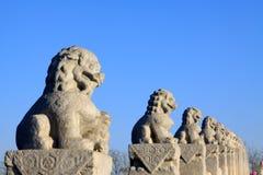 Stone lion sculptures in seventeen holes bridge railing Stock Image