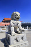 Stone lion stands guard in front of tiananmen Royalty Free Stock Photos