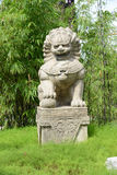 Stone Lion Statue. Stands Guard At A Park Stock Photos