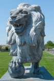 Stone lion, statue of a lion, lion with a ball royalty free stock photography