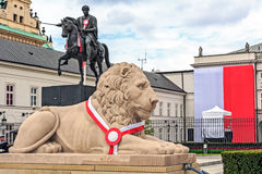 Stone lion and statue of Jozef Poniatowski Royalty Free Stock Images