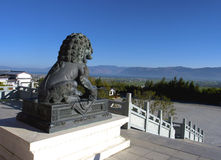 Stone lion statue overlooking city Royalty Free Stock Images
