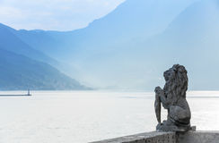 Stone lion statue in Perast, Bay of Kotor Stock Photos