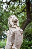 Stone Lion Statue in Savannah Park Stock Photos