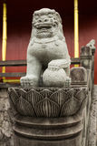Stone lion statue on the stair way to the castle. The stone lion statue in the stair to the Shuri Castle of Okinawa, represent the guarding or protecting from stock image