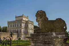Stone lion statues on the gates of the Villa Doria-Pamphili in Rome, Italy. Stone lion statues on the gates of the Villa Doria-Pamphili in Rome royalty free stock photo