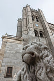 Stone lion and tower of the cathedral of Avila Stock Photo