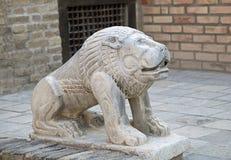 Stone lion, Uzbekistan Stock Photo