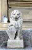 Stone lion of white granite Stock Photo