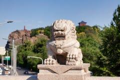 Stone lion on Xi Daqiao Bridge Urumqi Xinjiang China royalty free stock image