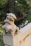 Stone Lion, Zhongshan Park, Shanghai, China. The stone lion on the bridge railing. The stone carving of China Royalty Free Stock Images