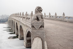 Stone lions on the ancient bridge Stock Photos