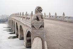 Stone lions on the ancient bridge Stock Photos
