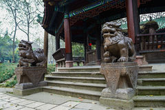 Stone lions before ancient pavilion,China Stock Photo