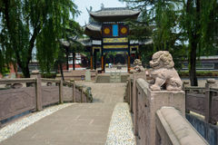 Stone lions on balustrades of ancient Chinese bridge Stock Image