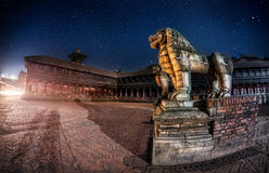 Stone lions at night in Bhaktapur Royalty Free Stock Photo