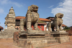 Stone lions statues in Bhaktapur Durbar Square, Nepal. Bhaktapur Durbar Square is the plaza in front of the royal palace of the old Bhaktapur Kingdom. It is one stock photography