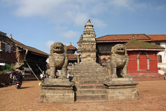Stone lions statues in Bhaktapur Durbar Square, Nepal Stock Photo