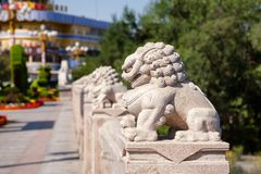 Stone lions on Xi Daqiao Bridge Urumqi Xinjiang China royalty free stock photos