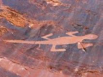 Stone Lizard. Lizard petroglyph chipped into rock at Dinosaur National Monument, Utah, U.S.A Royalty Free Stock Image
