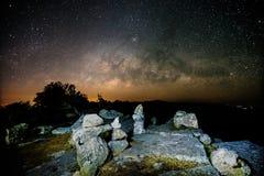 Stone lodge on night sky stars background Stock Photography