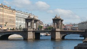Stone Lomonosov Bridge on The Fontanka River in the summer - St. Petersburg, Russia Royalty Free Stock Photos