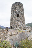 Stone lookout tower with loopholes. Ancient stone guard of cylindrical shape Royalty Free Stock Image