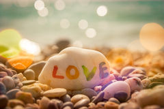 Stone with LOVE text on Sea Background Stock Images