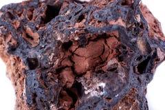Stone macro mineral goethite on a white background. Close up Royalty Free Stock Image