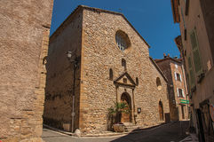 Stone made facade of ancient church in Châteaudouble. stock photo