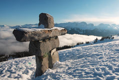 Stone Man. An inukshuk stands sentry over Whistler and Blackcombs mountain, British Columbia,  Canada Stock Photo