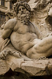 Stone man crying on the fountain. Statue located in Piazza Navona in the heart of Rome Stock Photos