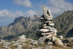 Stone man in the mountains. On Corsica Stock Photography