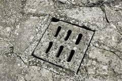 Stone manhole cover Royalty Free Stock Photos