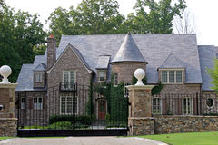 Stone Mansion. Behind iron gate Royalty Free Stock Photography