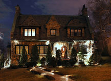 Stone mansion at night, frontal view. Front view of a stone mansion lit up at night Stock Photo