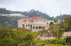 Stone Mansion on Tropical Hill. A huge stone mansion on top of a tropical hill royalty free stock photo