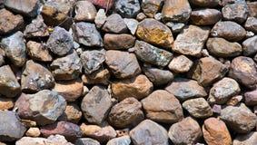 Stone. Many stones lay stacked of fence stock photo