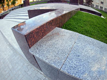 Stone marble borders on a city street close up. With wide angle distortion view Stock Photography