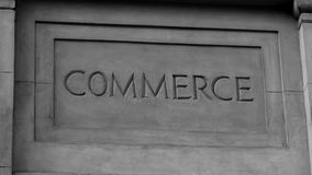 `Commerce` In Roman Style Stone Carving Royalty Free Stock Images