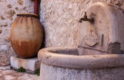 Stone marble washbasin with fish and a big jar royalty free stock photography