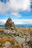 Stone marker. Stone trail markers leading the way up to the top of Mount Washington Stock Photo