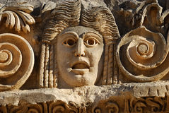 Stone Mask. Ancient theatrical mask carved in stone Stock Image