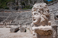 Stone mask and ancient amphitheater, Myra (Turkey) Royalty Free Stock Photo