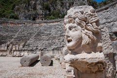 Stone mask and ancient amphitheater, Myra (Turkey) Royalty Free Stock Photo