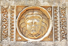 Stone mask, Myra, Turkey Royalty Free Stock Photos