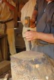 Stone mason. Man shaping a block of stone Royalty Free Stock Photos